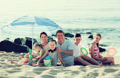 Active family with  children together on beach sitting Stock Photo