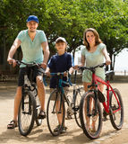 Active family with cycling through street Royalty Free Stock Photo