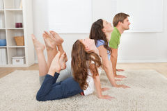Active Family Doing Yoga At Home Stock Photography