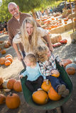 Active Family Enjoys a Day at the Pumpkin Patch. Adorable Young Family Enjoys a Day at the Pumpkin Patch Royalty Free Stock Photography