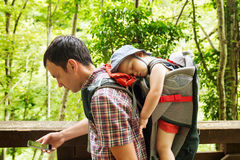 Active family hiking with 1,5 years child in carrier. On the background of a nature. Slovenia, Tolmin, Waterfalls of the Kozjak, Tolmin Gorges royalty free stock photos