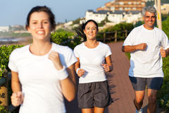 Active family jogging. Happy active family jogging in the morning stock photos
