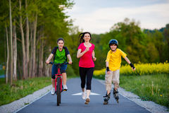 Free Active Family - Mother And Kids Running, Biking, Rollerblading Royalty Free Stock Photography - 36888997