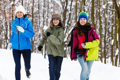 Active family - mother and kids running outdoor in winter park Royalty Free Stock Images