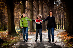 Active family - mother and kids walking outdoor stock photos