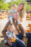 Active Family Portrait at the Pumpkin Patch. Attractive Family Portrait in a Rustic Ranch Setting at the Pumpkin Patch Royalty Free Stock Images