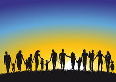 Active family silhouettes. Inter generational silhouettes of active family or parents with children.  Sunrise or sunset background Royalty Free Stock Images