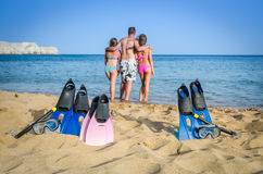 Active family on tropical beach Stock Photography
