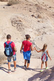 Active family walk in the desert Royalty Free Stock Image