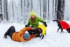 Active family walk the dog in the winter forest. Stock Photo