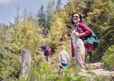 Active family walk in mountain forest Stock Photography