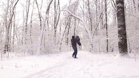 Active father and son playing in winter park. stock footage