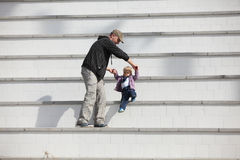 Active fatherhood. Father supporting his daughter development Royalty Free Stock Photography