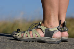 Active feet wearing sports beach sandals royalty free stock photos