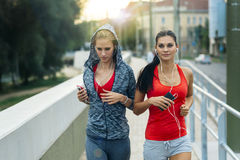 Active female joggers running outdoors Stock Image