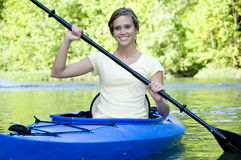 Active female in Kayak Stock Photography