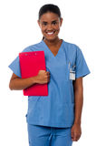 Active female nurse holding clipboard, at duty Stock Image
