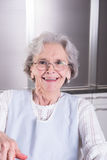 Active female pensioner is laughing into camera Stock Photo