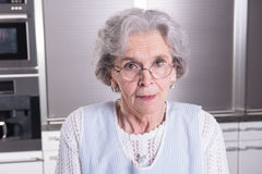 Active female pensioner is looking into camera Royalty Free Stock Photo