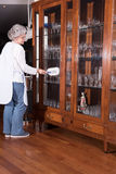 Active female senior is cleaning furniture Royalty Free Stock Images