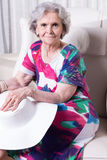 Active female senior is waiting to go out Royalty Free Stock Photos