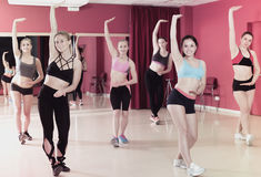 Active females dancing excited posing Royalty Free Stock Image