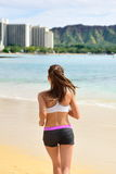 Active fit female sport runner jogging on beach Stock Photography