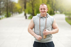 Active fit man with jump rope. Royalty Free Stock Photos