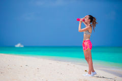 Active fit young woman in her sportswear during beach vacation Royalty Free Stock Image