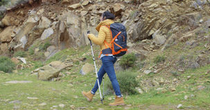 Active fit young woman on a hiking trail Stock Image