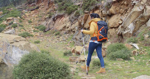 Active fit young woman on a hiking trail Stock Images