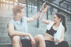 Active friends smiling and giving high five Stock Photos