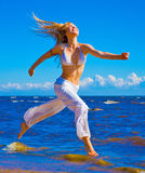 Active girl. Running on a beach Royalty Free Stock Photography