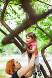 Active girl climbing on tree Royalty Free Stock Images