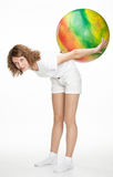 Active girl doing exercise with a fitball Royalty Free Stock Images