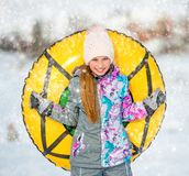 Active Girl Holding Snow Tubing Royalty Free Stock Photo