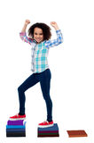 Active girl kid climbing on notebooks Royalty Free Stock Images