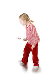 Active girl with lollypop Royalty Free Stock Photography
