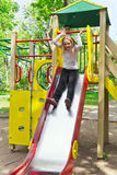 Active girl on nursery platform in summer Stock Images