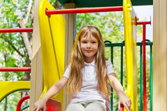 Active girl on nursery platform in summer Royalty Free Stock Photos