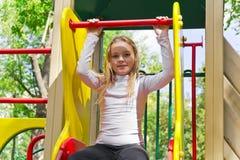 Active girl on nursery platform in summer Royalty Free Stock Photo
