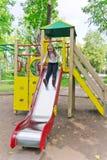 Active girl on nursery platform in summer Royalty Free Stock Image