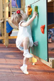 Active girl in playground. On climb wall Royalty Free Stock Images
