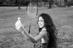 Active girl playing badminton. In outdoor court in summer Stock Photo