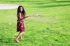 Active girl playing badminton in outdoor court in summer Royalty Free Stock Photography