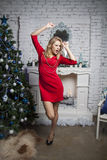 Active Girl in red party dress dance Stock Photo