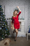 Active Girl in red party dress Royalty Free Stock Images