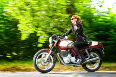 Active girl riding on the motorbike, slow motion Royalty Free Stock Photo