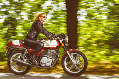 Active girl riding on the motorbike, slow motion Royalty Free Stock Photography