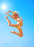 Active girl in the sky Stock Image